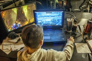 Child playing HEWMEN-enabled games